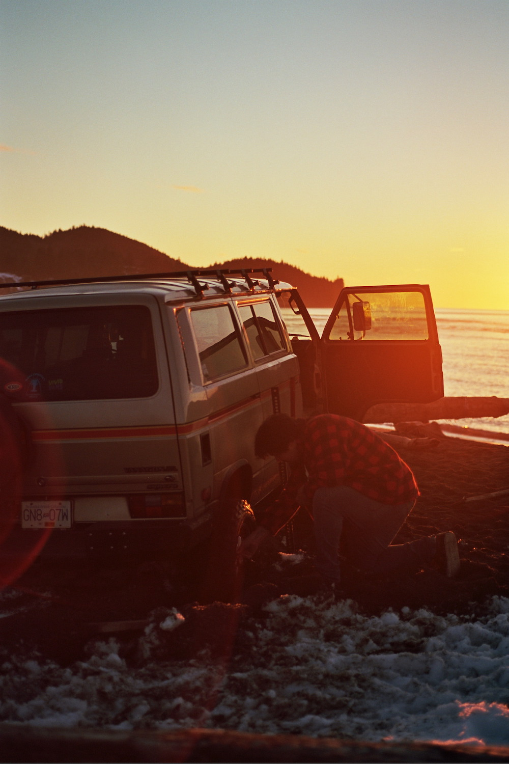 vanagon outlaws parked at sunset